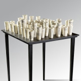 +70 pieces installation  Press-headlines transfers on glazed ceramic. Oversize wooden table  160x90x80 cm - Alfredo Eandrade